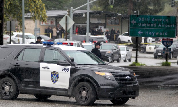 Oakland police on the scene at an active shooter incident near the intersection of Golf Links Road and 98th Avenue in Oakland, Calif., on Friday, Feb. 17, 2017. The suspect was neutralized, but the scene still remains closed off. (Anda Chu/Bay Area News Group)
