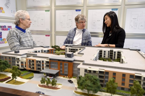 Leslie Chalmers, left, and Jean Marana, of Walnut Creek, go over plans for their new two bedroom two and half bath condominium with Staci Chang, director of sales and marketing at Viamonte Senior Living in Walnut Creek, Calif., on Monday, Feb. 13, 2017. Chalmers, a retired computer security specialist, and Marana a retired clinical social worker, were the first ones on the waiting list to sign up to move to Viamonte. Units range in size from a one bedroom one and a half bath 750 square feet apartment to a two bedroom plus den two and a half bath 1525 square feet apartment. (Susan Tripp Pollard/Bay Area News Group)