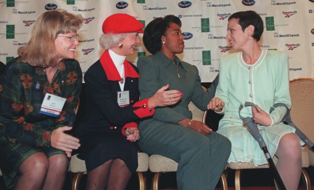 Shown from left, Gail Emery, Barbara Ann Scott-King, Evelyn Ashford and Diana Golden Brosnihan share a moment during a news conference announcing their induction into the Women's Sports Hall Fame at the Women's Sports Foundation's18th Annual Salute in Sports, Monday, Oct. 13, 1997 in New York. Gail Emery will be inducted as the world's most accomplished synchronized swimming coach, Barbara Ann Scott-King, as North America's first figure skating champion, Evelyn Ashford, as America's top female sprinter, and Diana Golden Brosnihan, as an Olympic disabled skating champion. (AP Photo/Emile Wamsteker)
