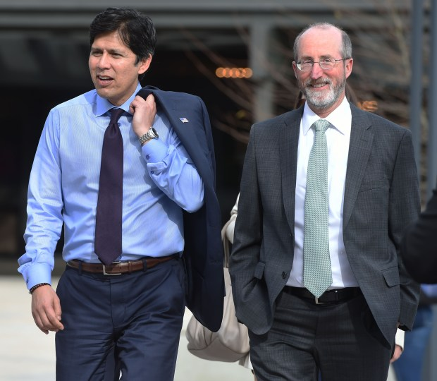 "California State Senate Pro Tem Kevin de Leon arrives with Senator Steve Glazer at an event where he speaks about his proposed Senate Bill 54, the California Values Act, which would make California a sanctuary state ensuring that police, schools, hospitals and courts ""remain accessible to Californians from all walks of life,"" at Diablo Valley College in Pleasant Hill, Calif., on Thursday, March 16, 2017. (Susan Tripp Pollard/Bay Area News Group)"