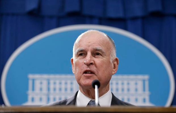 FILE - In this Jan. 10, 2017, file photo, California Gov. Jerry Brown discusses his 2017-2018 state budget plan he released at a news conference in Sacramento, Calif. After years of prep work, Gov. Jerry Brown's finance department decided Friday, March 3, 2017, that California's $64 billion high-speed rail project is ready to lay some track. The administration approved the rail authority's request to spend $2.6 billion on work in the Central Valley. The decision lets the authority ask the state treasurer's office to sell a portion of the nearly $10 billion in bonds voters approved in 2008 for a bullet train. (AP Photo/Rich Pedroncelli, File) ORG XMIT: LA526