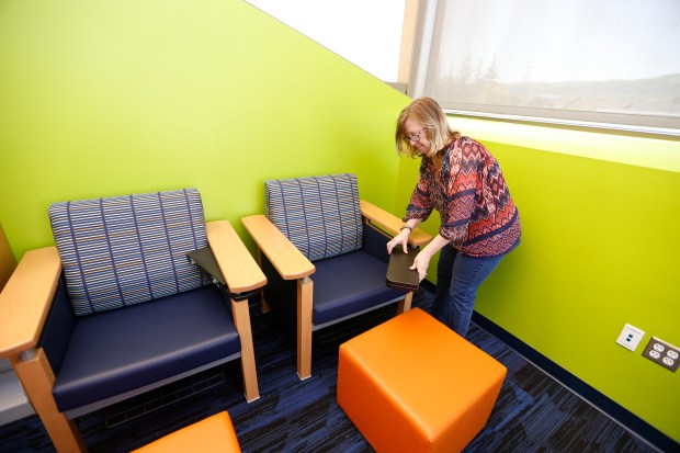 Community Library Manager Nancy Kreiser shows of a chair and desk in the teen area of the newly remodeled San Ramon Library on Thursday, March 30, 2017, in San Ramon, Calif. The library had a $6 million remodeling and expansion, and is now set to reopen April 15, 2017. (Aric Crabb/Bay Area News Group)
