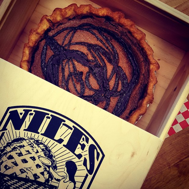 A pie from Niles Pie Company in Union City is seen in one of the wooden,reusable pie boxes the shop gives to its repeat customers to cut down on waste. The bakery recently won a business efficiency award from StopWaste for its pie box program. (Photo courtesy Carolyn Berke)