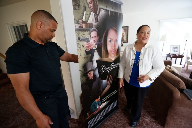 "Regina Mason, right, and film director director Sean Durant, left, are photographed on Tuesday, April 4, 2017, in Oakland, Calif. Mason spent 15 years tracking down the story of one of her ancestors, William Grimes, who was a fugitive slave that traveled along the Underground Railroad to freedom and authored the first fugitive slave narrative in U.S. history. A film by Sean Durant about her search ""Gina's Journey, the search for William Grimes"" will be shown at the Oakland Film Festival Thursday, April 6, 2017. (Aric Crabb/Bay Area News Group)"