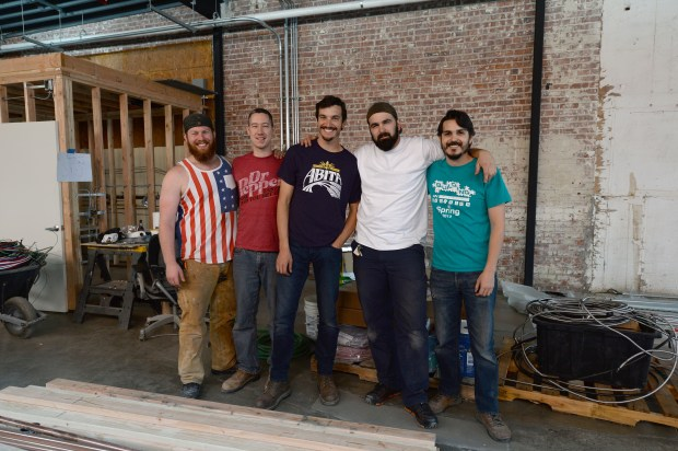 Jess Jackson, far left, Micheal Tucker, Nick Riccobono, Sean Macias and Dennis Boettcher, far right, stand at the future site of Five Suns Brewing in downtown Martinez, Calif., on Saturday, April 15, 2016. The East Bay is fast becoming a mecca for craft breweries. (Dan Honda/Bay Area News Group)