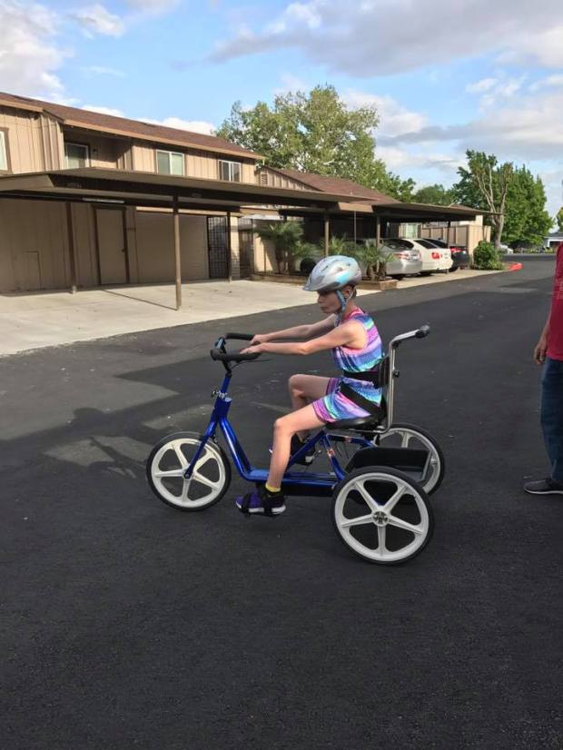 Charlotte Luther adaptive tricycle gave her the freedom and independence she had lost after brain surgery left her with limited mobility. After it was stolen on Monday while Charlotte was in the hospital, police scoured the city for it and ultimately returned it to her that night, undamaged. (Photo provided by Cate Luther)