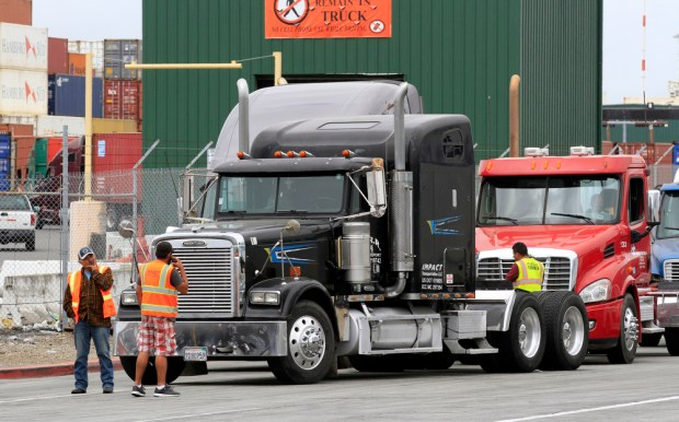 Trucks are lined up along the length of Middle Harbor Road due to a work stoppage at the SSA terminal at the Port of Oakland in Oakland, Calif., on Thursday, May 25, 2017. (Laura A. Oda/Bay Area News Group)