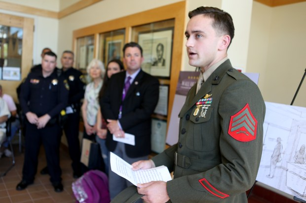 U.S. Marine Sgt. Peyton Whitted, a member of the Piedmont High School Class of 2012 speaks at a groundbreaking ceremony for the planned Wall of Honor at the Ambassador Christopher Stevens Memorial Library at Piedmont High School, in Piedmont, Calif., on Thursday, May 18, 2017. The planned extension will include a digital repository, searchable by name of over 1,200 Piedmont service members. (Anda Chu/Bay Area News Group)