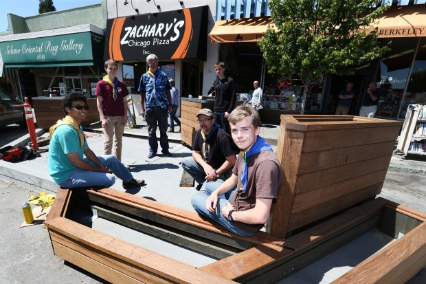 Mitchell Celaya, left, Rowen Halpern, scout master Mike Borough, Myles Halpern, assistant scout master Alex Bergtraur and Emmet Hegarty all from the Berkeley's Boy Scout Troop 6, pose for photo in a new parklet they are building on Solano Avenue in Berkeley, Calif., Saturday, May 13, 2017. The parklet is being built under the direction of Eagle Scout candidate Hegarty. (Ray Chavez/Bay Area News Group)