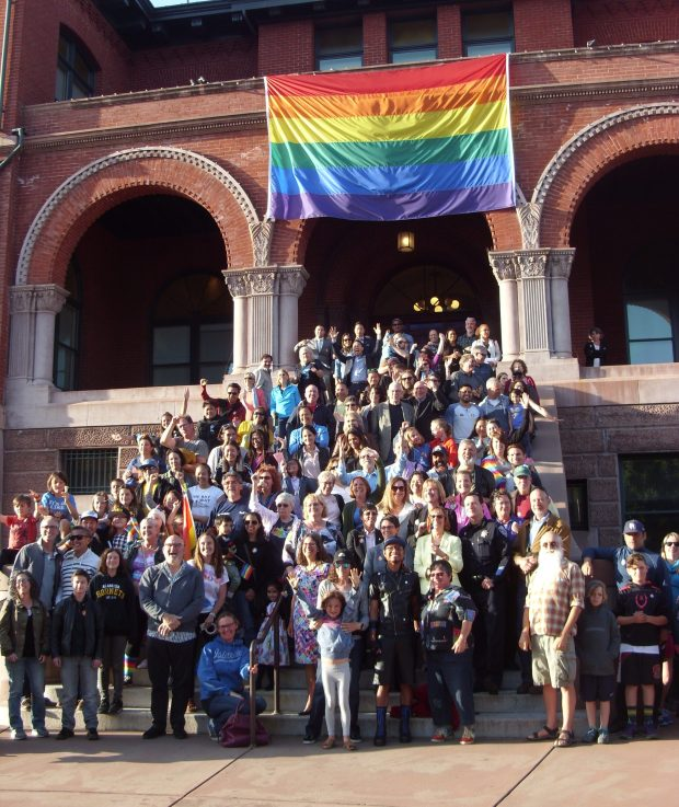 Alamedans gather on the steps of City Hall with Mayor Trish Spencer to celebrate LGBTQ Pride Month and take an official group photo on June 7 during a break in the City Council meeting.
