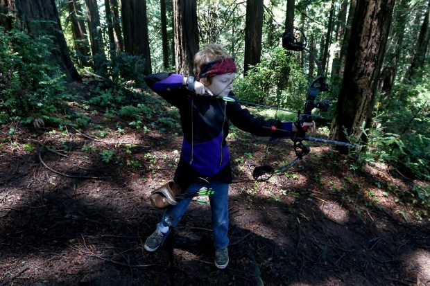 """I rather be here (shooting with his compound bow) than playing video games, says Landon Baggs, 8, of Novato, after shooting a 3-D foam animal with a compound bow during the 38th annual Western Roundup hosted by the Redwood Bowmen archery club in Oakland, Calif., on Sunday, June 25, 2017. 240 contestants of different skill levels ranging from 8-year-old and above participated in the outdoor event which is attracting more women due to popular film and shows such as the Hunger Games, the Game of Thrones and others, said Nail Rubin, president of the archery club. (Ray Chavez/Bay Area News Group)"