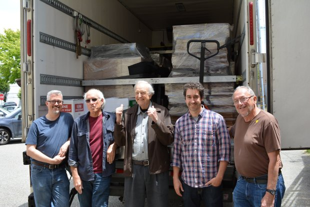 COURTESY Maureen Gosling/ARHOOLIE RECORDSMusic archivist Chris Strachwitz is flanked by two Smithsonian representatives and Adam Machado and Tom Diamant in front of the Fed Ex truck taking Arhoolie recordings to Washington, D.C.