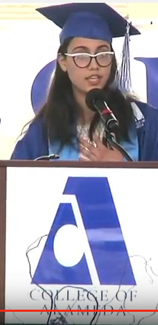 College of Alameda's valedictorian Fudhah Al Khafaji addresses the commencement crowd. The Iraqi native will transfer to UC Berkeley this fall and major in chemical biology. (College of Alameda)