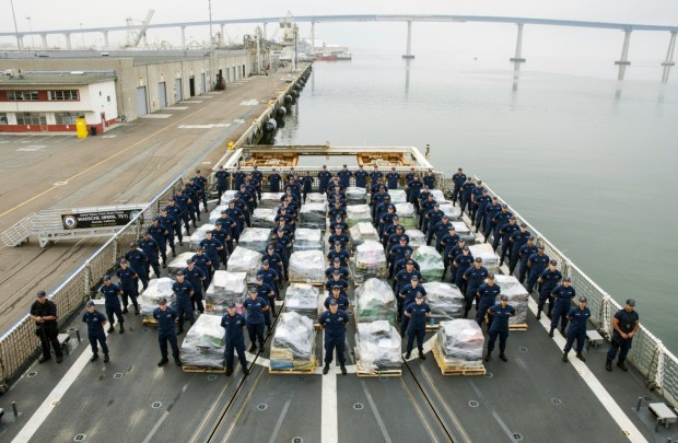 In this photo provided by the U.S. Coast Guard the crew of the Coast Guard Cutter Waesche, prepare to offload approximately 18 tons of cocaine at 10th Ave. Marine Terminal in San Diego on Thursday, June 15, 2017. The drugs brought ashore Thursday from the cutter Waesche were seized by the crews of eight Coast Guard cutters in the Eastern Pacific from late March through this month. The Coast Guard says it has been focusing personnel and resources on known drug transit zones in the Pacific during the last two years. (Petty Officer 3rd Class Davonte Marrow/U.S. Coast Guard via AP)