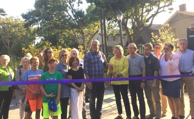 Piedmont residents, city officials, staff and supporters prepare to cut the ribbon at the Linda Kingston triangle dedication June 22. (Sarah Tan/For Bay Area News Group)