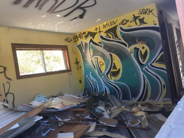 Graffiti adorns the interior of a mobile home, seen on July 3, 2017, that was dumped on Cummings Skyway outside Crockett, Calif., in May. (Tom Lochner)
