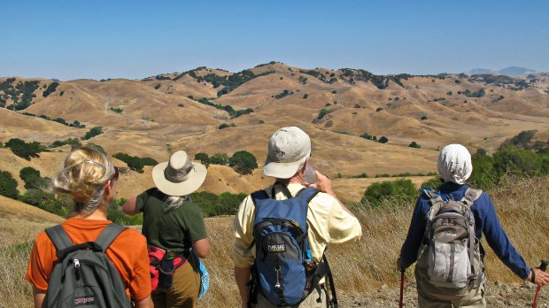 A group of hikers looks at the scenery in the East Bay Municipal Utility District's Pinole Watershed Ridge Trail.
