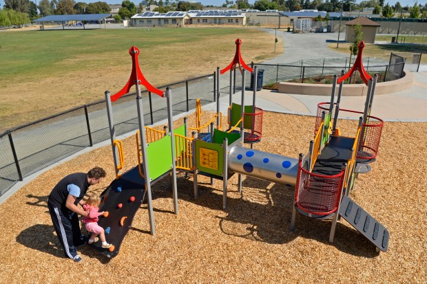Brian Colligan, of Concord, plays with his daughter Chloe, 2, at the newly built playground at Meadow Homes Park in Concord, Calif. on Saturday, July 1, 2017. (Jose Carlos Fajardo/Bay Area News Group)