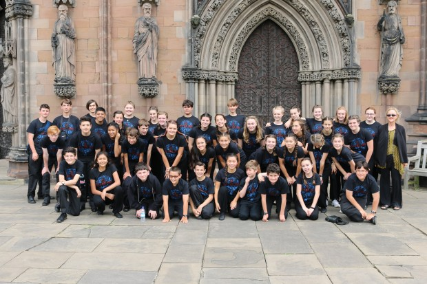 The Piedmont East Bay Children's Choir poses for a group photograph in front of Litchfield Cathedral in England during a tour this year. (Courtesy of Marielle Hayes)