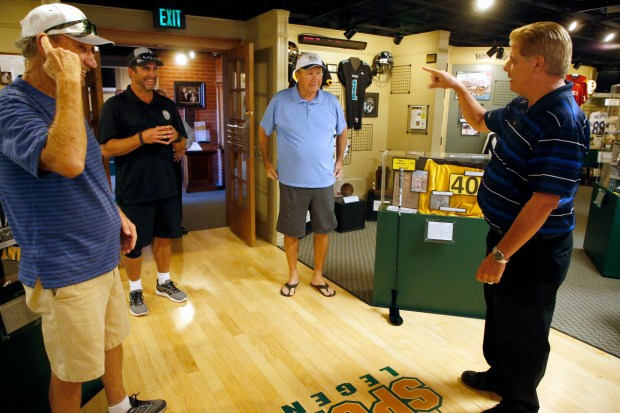 Rally Rounsaville, left, Alex Sanchez, second from left, Gene Rounsaville, and Eddie Beaudin are photographed in the Antioch Sports Legends museum on Thursday, Aug. 24, 2017, in Antioch, Calif. The museum will induct 15 new members and one new championship team for it's class of 2017 in October. (Aric Crabb/Bay Area News Group)