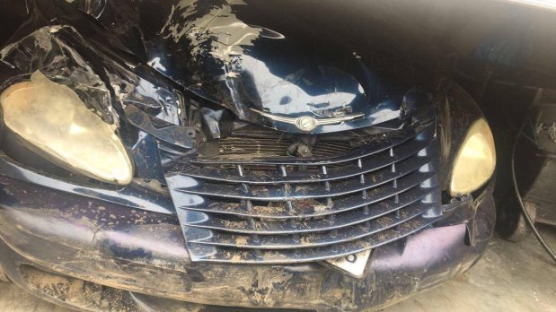 The front of El Cerrito resident Dru Billings' PT Cruiser shows damage after it crashed into a parked car and barrier after being chased by an arson suspect last week. (Picture by Dru Billings, Wednesday, Aug. 9, 2017)