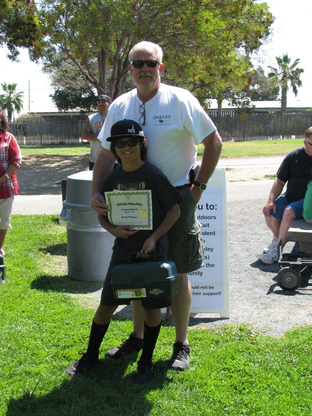 2016 Oakley Mayor Kevin Romick poses with Sammy Gutierrez, the Biggest Fish award winner for the 11 through 15 age group last year. (Photo courtesy of the Oakley Recreation Department.)