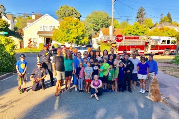This block on York Drive was among seven neighborhoods taking part in Piedmont's first National Night Out on Aug. 1. Neighborhood residents gather for a group photo. (Piedmont Police Department)