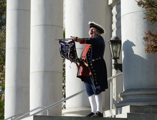 Town crier Redmond O'Connell, of Martinez, who goes by the stage name Redmond O Colonies, demonstrates his craft as he cries out about all the great parks in the area on the steps of the Contra Costa County Finance Building in Martinez, Calif., on Thursday, Sept. 3, 2015. (Susan Tripp Pollard/Bay Area News Group)