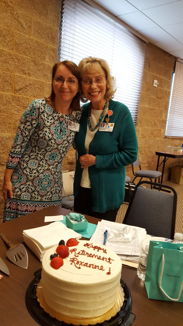 Maria Amadea (left), manager of Caring Hands, was joined by colleagues and friends at a celebration honoring Director of Guest and Volunteer Services Roxanne Foster (right), who started Caring Hands in 1998. Foster is retiring from John Muir Health.