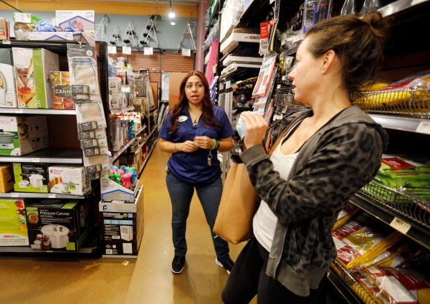 Danya Lucchesi from Lafayette talks to one of the customer service representatives about when they expect more air purifiers and masks at the ACE Hardware store in Walnut Creek, Calif., on Thursday, Oct. 12, 2017. (Laura A. Oda/Bay Area News Group)