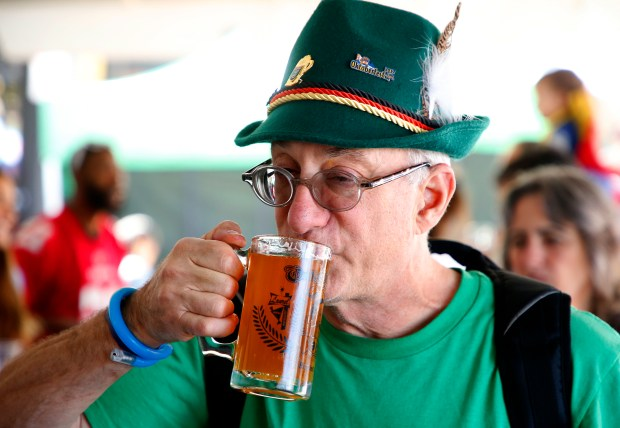 Bob Bloom drinks a beer during the 10th annual Oaktoberfest on Sunday, Oct. 1, 2017, in Oakland, Calif. (Aric Crabb/Bay Area News Group)