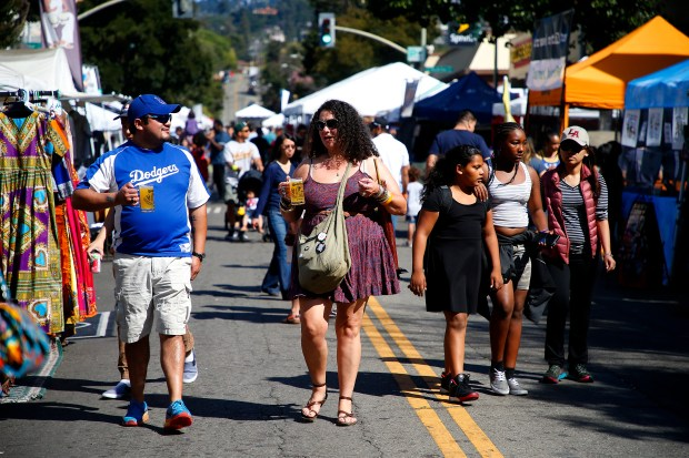 Visitors walk along Fruitvale Avenue during the 10th annual Oaktoberfest on Sunday, Oct. 1, 2017, in Oakland, Calif. (Aric Crabb/Bay Area News Group)
