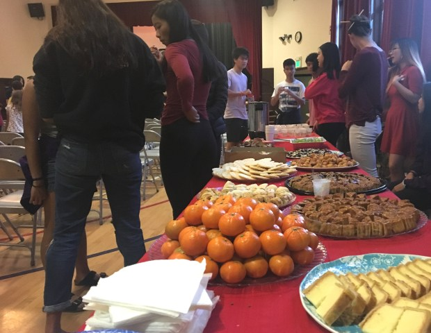 Mooncakes, tangerines, Japanese rice cakes and fortune cookies are set out for visitors at the Piedmont Asian American Club's Mid-Autumn Moon Festival on Oct. 6.(Sarah Tan/For Bay Area News Group)