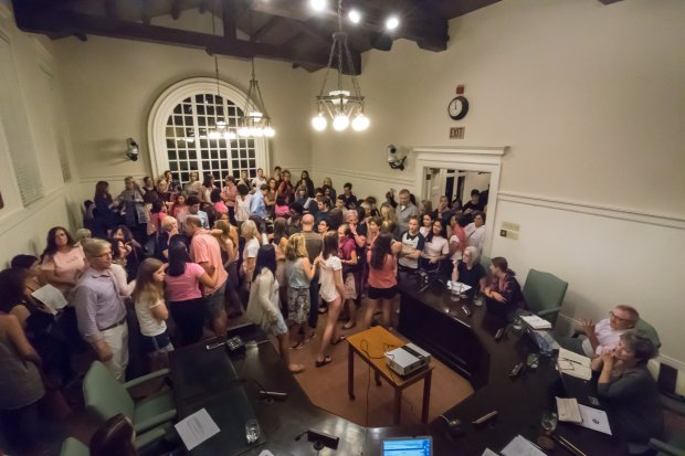 An overflow crowd of Piedmont parents and students pack the Oct. 25 Piedmont Unified School District Board of Education meeting to criticize the school board and the superintendent for allowing Piedmont High School history teacher Mark Cowherd to return to teaching. Cowherd was recently disciplined and investigated by the Piedmont district for inappropriate behavior and remarks to several female students over years, but kept his job.(Photo by Paul Kuroda)