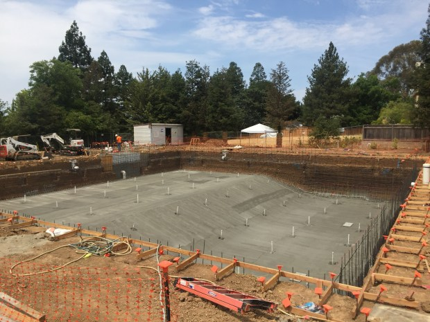 A photo of the 10-lane competition swimming pool and diving wellunder construction at Carondelet High School's new Walnut Creek athletic complex.