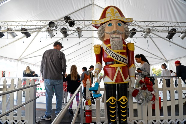 A giant nutcracker greets skaters as they walk up the ramp to enjoy Brentwood on Ice in Brentwood, Calif. on Saturday, Nov. 18, 2017. This is downtown Brentwood's first ice rink. (Jose Carlos Fajardo/Bay Area News Group)