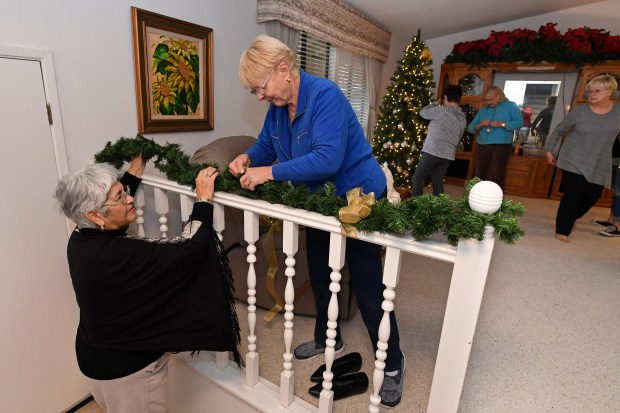March Rocha, of Antioch, from left, and Susan French, of Antioch, help decorate the front entrance of the home of Martha Viera Parsons in Antioch, Calif., on Monday, Dec. 20, 2017. The home is being decorated for the upcoming 63rd annual Christmas House Tour on December 10 held by the Woman's Club of Antioch. (Jose Carlos Fajardo/Bay Area News Group)