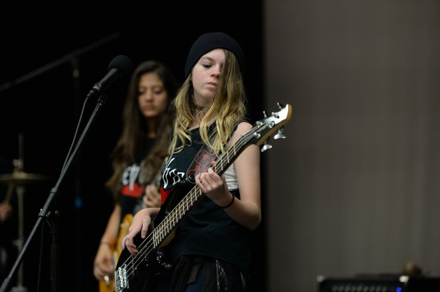 Halli Boisvert, 12, of the band Stepback plays at Adam's Middle School in Brentwood, Calif., on Friday, Nov. 3, 2017. The young rock band recently played at Dell Osso Farms in Lathrop for their Halloween festivities and have started to get more gigs. (Dan Honda/Bay Area News Group)