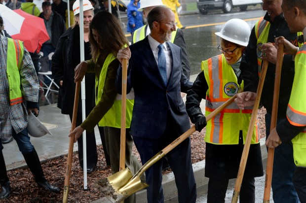 State Senator Steve Glazer, center left, and Moraga Mayor Teresa Onoda, center right, share a laugh at a public ground-filling to celebrate the completion of the sinkhole repair at Rheem Blvd. and Center Street in Moraga, Calif., on Thursday, Nov. 16, 2017. The sinkhole, which appeared in March of 2016, became an unofficial resident of the town known as Sinky McSinkhole, with its own Twitter and Facebook accounts. (Dan Honda/Bay Area News Group)