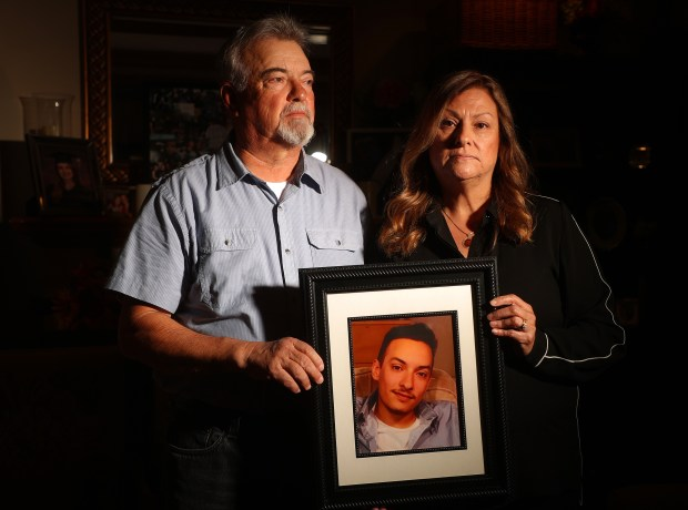 Manuel Vega, left, and his wife Maria are photographed with a picture of their son Alex Vega on Wednesday, Nov. 29, 2017, in San Bruno, Calif. Alex Vega died in the Ghost Ship fire on December 2, 2016. (Aric Crabb/Bay Area News Group)