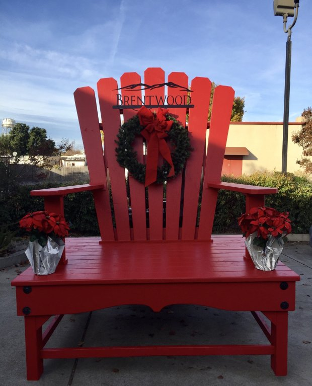 The new red wooden chair in front of City Hall, which is nine-foot-tall andseven-foot wide, is the brainchild of Mayor Bob Taylor who commissioned Al Herrera of Big Al's Heavy Metal Furniture to design and build it. COURTESY PAULA KING