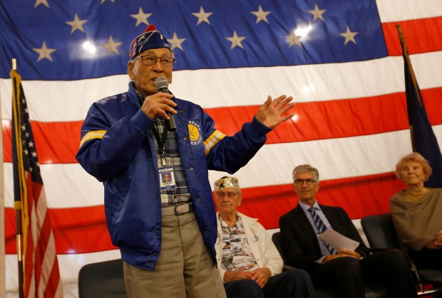 World War II veteran four-time Purple Heart recipient Lawson Sakai, of Morgan Hill, speaks during a remembrance marking the 76th anniversary of Pearl Harbor at the USS Hornet Museum in Alameda, Calif., on Thursday, Dec. 7, 2017. Pearl Harbor was bombed on Dec. 7, 1941, killing 2,403 Americans and wounding 1,178 on the island of Oahu. (Jane Tyska/Bay Area News Group)