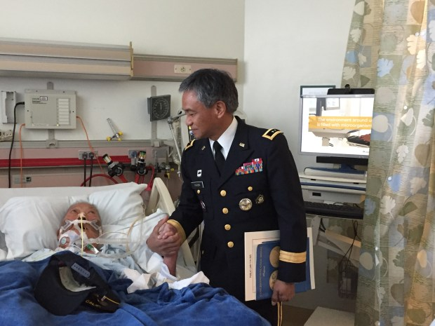 Ramon Regalado received his Congressional Gold Award on Dec. 1, at a private ceremony, from Maj. Gen. (Ret.) Antonio Taguba in the ICU at Kaiser Permanente Hospital in Richmond.