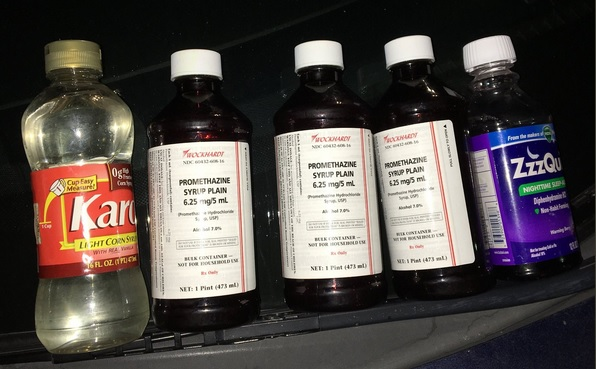 Police arrested a parolee early Friday and seized bottles of substances that included prescription syrup. (Emeryville Police Department)
