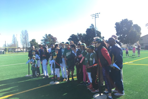 Alameda Mayor Trish Herrera Spencer, Recreation and Park Department Director Amy Wooldridge, and members of the Alameda Little League Challenger Division pose at the ribbon-cutting of Estuary Park's renovated synthetic field on Jan. 20.