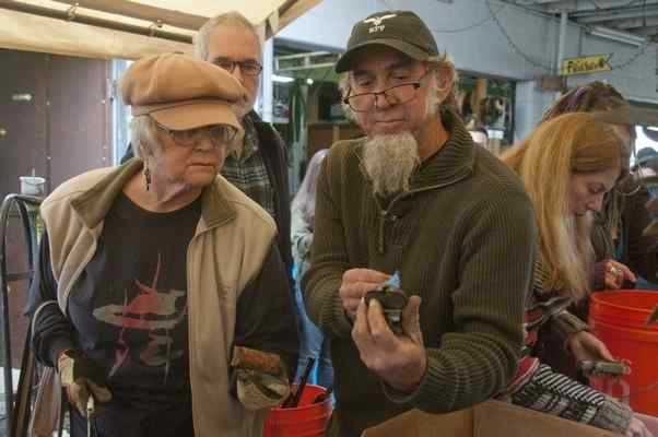Vallejo artist Jean Cherie gets some advice on working with gun metals from Shannon O'Hare at the distribution of dismantled weapons to commissioned artists for the Poblete Foundation's 'Art of Peace.' (S.N. JACOBSON — CONTRIBUTED PHOTO)