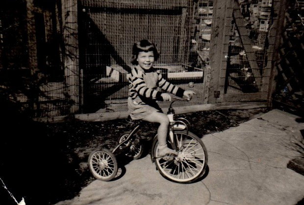 Nancy Gannon-Mongerson is photographed as a child in 1951, enjoying her tricycle. (Courtesy Darleen Sherman)