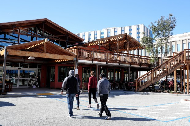 Customers walk toward the new Chow Oakland Cafe, Bakery & Market on Piedmont Avenue. (Ray Chavez/Bay Area News Group)