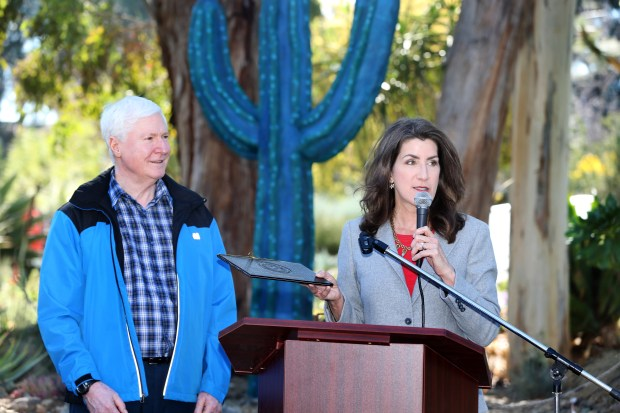 Assemblywoman Catharine Baker, right, presents a Certificate of Memoriam in honor of late Ruth Bancroft to Peter Bancroft, 73, and the Bancroft family during a celebration of her life at the Ruth Bancroft Garden In Walnut Creek, Calif., on Saturday, Feb. 17, 2018. Bancroft, founder of the Ruth Bancroft Garden, died on November 26, 2017 at age 109. (Ray Chavez/Bay Area News Group)