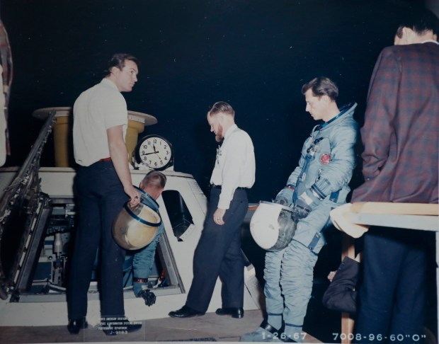 A copy of a photo of Wallace Johnson, second from right in the blue space suit, during extensive testing after the tragic flash fire that killed three astronauts in January 1967. (Courtesy of Wallace Johnson)